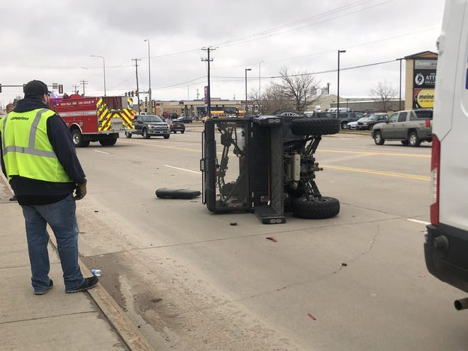 The utility vehicle hit the back of the truck and rolled when attempting to change lanes.