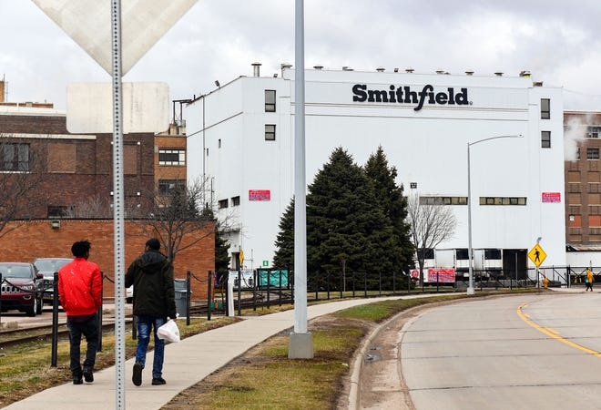 Employees walk into work on Wednesday, March 24, 2021 at the Smithfield Foods in Sioux Falls.