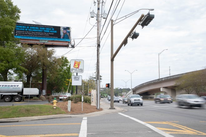A digital billboard at the corner of Thomasville Road and Market Street displays an advertisement purchased by the Big Bend Police Benevolent Association discouraging parents from sending their children to college in Tallahassee, citing the city's crime and murder rates amid a bitter contract dispute between the Tallahassee Police Department union and the city of Tallahassee Wednesday, March 24, 2021.