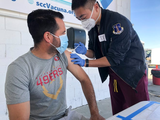 03 - Mauricio Chavez of Hollister gets a COVID-19 vaccine at Monterey Mushrooms in Morgan Hill on Feb. 28, 2021. He works at a neighboring mushroom farm. Many California farmworkers still face obstacles getting the vaccine.