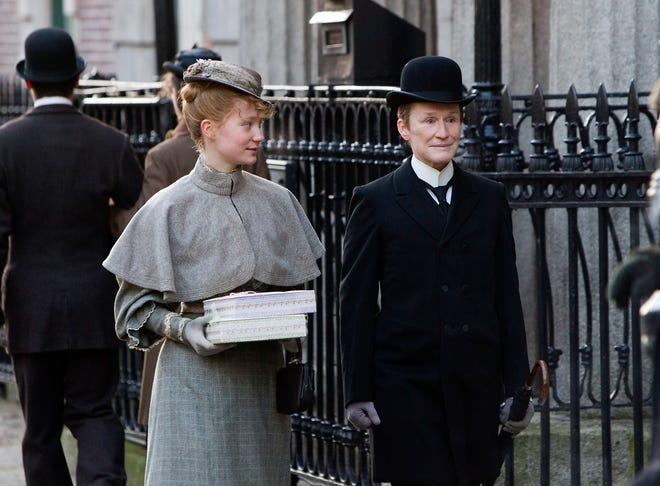 "Albert (Glenn Close, right) romances Helen (Mia Wasikowska) in period drama ""Albert Nobbs."""