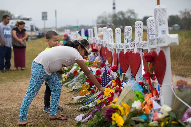 Bella Araiza is pictured at a makeshift memorial honoring the 25 people who died following the shooting at First Baptist Church of Sutherland Springs, Texas, in 2017.