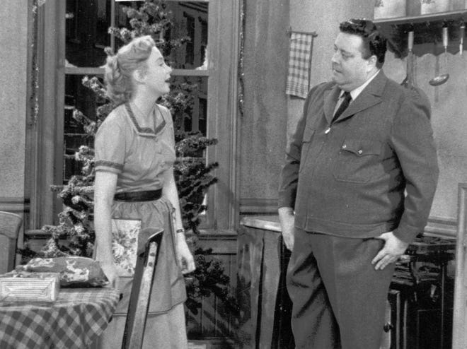 "Jackie Gleason portrays Ralph Kramden and co-star Audrey Meadows, Alice Kramden, in the tv series ""The Honeymooners"" in 1955."