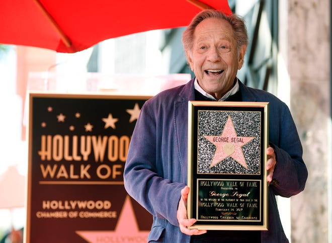 Actor George Segal poses with a replica of his new star on the Hollywood Walk of Fame on Tuesday, Feb. 14, 2017.