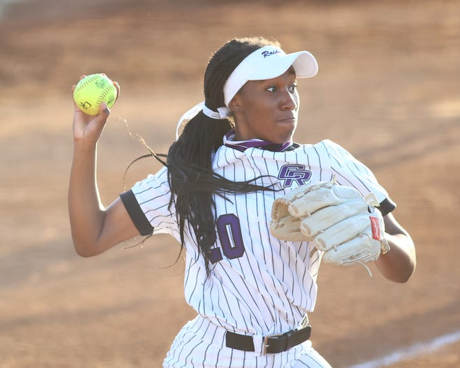 Tyra Thompson fields a bunt for Cedar Ridge and throws to first base to make the out against Westwood in the first inning of a district game March 23 at Cedar Ridge High School.