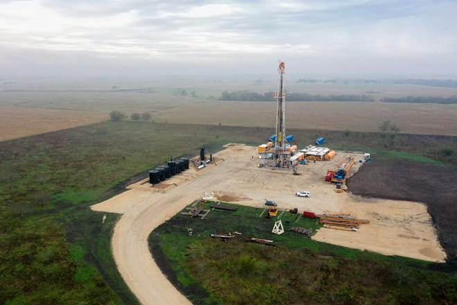 A drilling rig is shown in January near Gonzales, Texas. Gas and oil wells also bring to the surface geothermal heat that can be harnessed as an energy source.