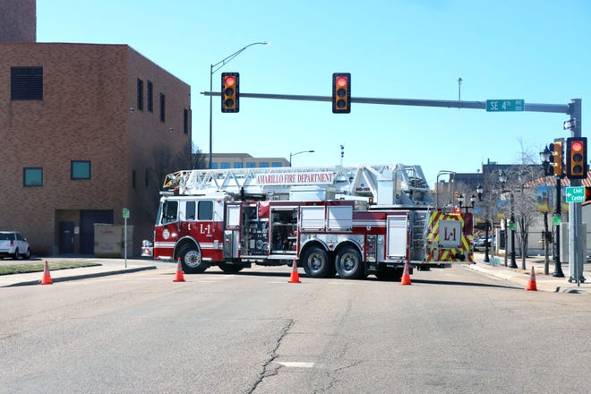 A firetruck stands by a block away and blocks traffic as crews work on a gas leak at the corner of Pierce and Fifth streets in downtown Amarillo Thursday morning. A firefighter on scene said no buildings had been evacuated and the traffic block was just a precaution.