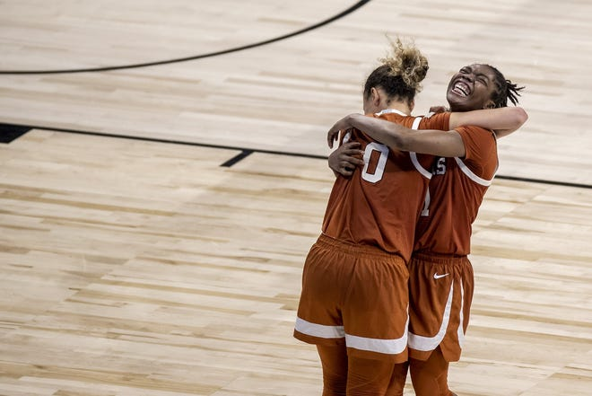 Guards Celeste Taylor, left, and Joanne Allen-Taylor celebrate the Longhorns' 71-62 win over UCLA in the second round of the NCAA Tournament at the Alamodome on Wednesday night. Taylor matched her season high with 24 points.
