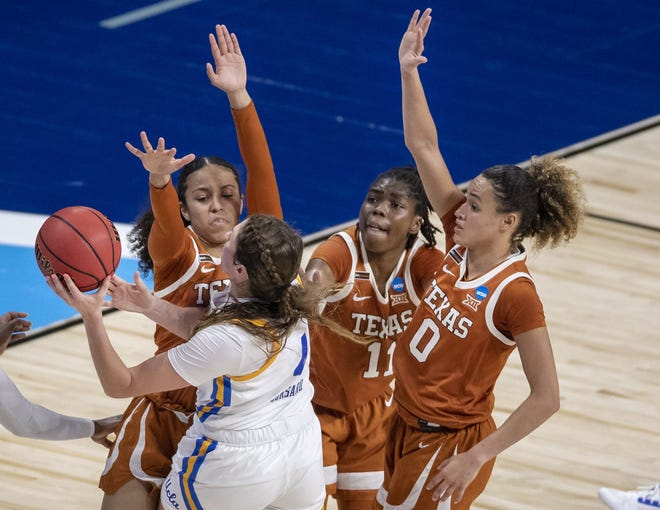 UCLA guard Kayla Owens is smothered by Texas defenders, from left, Karisma Ortiz, Joanne Allen-Taylor and Celeste Taylor during the first half of the Longhorns' 71-62 win Wednesday night. The third-seeded Bruins managed only 14 first-half points.