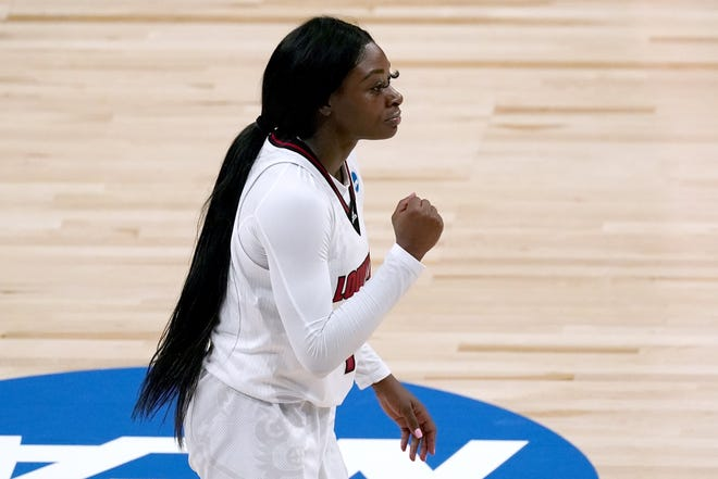 Louisville guard Dana Evans celebrates after scoring against Northwestern on Wednesday. Evans led the Cardinals on one of the biggest comebacks in the history of the NCAA Tournament.