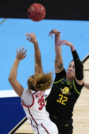 Oregon forward Sedona Prince shoots over Georgia's Javyn Nicholson during the Ducks' 57-50 win in the second round of the NCAA Tournament at the Alamodome on Wednesday. The Liberty Hill native tied a career high with 22 points in the victory.