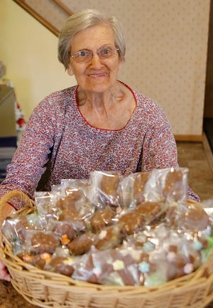 Betty Ferrier with a basket of her Easter candy recipes.
