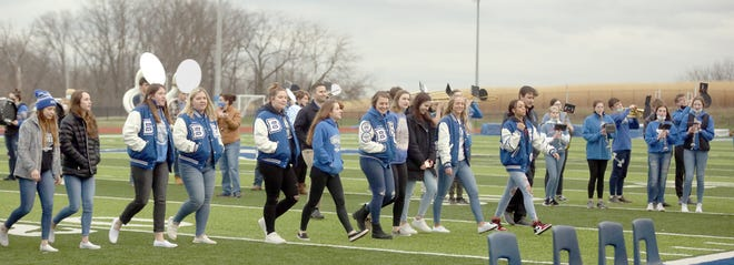Members of the Boonville Lady Pirates basketball team makes its entrance during a community rally Wednesday night at Gene Reagan field, honoring them for winning a state title last weekend in Springfield.