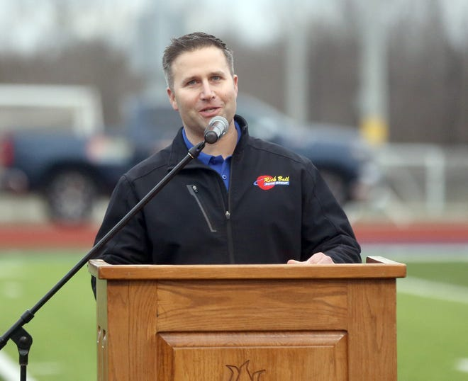 Ross Ball, a member of the 1998 state championship Boonville Pirates football team, speaks to the crowd during the community rally Wednesday night at Gene Reagan field.