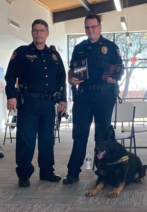 Early Police Chief David Mercer (left) stands next to K-9 officer Brandon McMillian, who retired Tuesday from the Early Police Department along with his K-9 partner Jambo. McMillian, who will pursue private business, will serve as a reserve officer with the department.