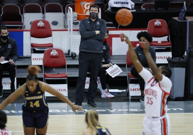 Ohio State Buckeyes head coach Kevin McGuff watches as forward Tanaya Beacham (35) shoots free throws during the third quarter of the women's college basketball game against the Michigan Wolverines at Value City Arena in Columbus on Thursday, Jan. 21, 2021.