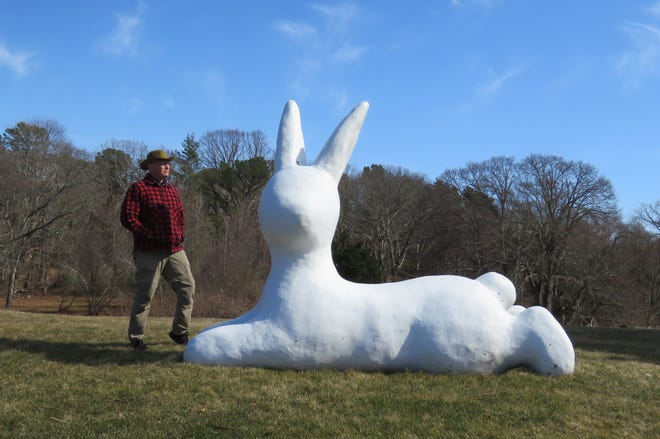 Amazed man with big bunny in Barnstable.