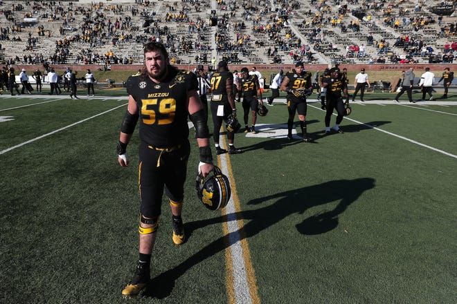 Missouri offensive lineman Case Cook walks on the field Dec. 5 when the Tigers played Arkansas at Faurot Field.