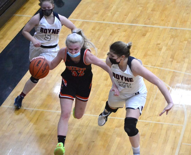 Cheboygan junior guard Marah Roberts (middle) looks to get by Boyne City defenders Jordan Noble (left) and Ally Herrick (right) during the first half of a Division 2 girls basketball district semifinal in Cheboygan on Wednesday.