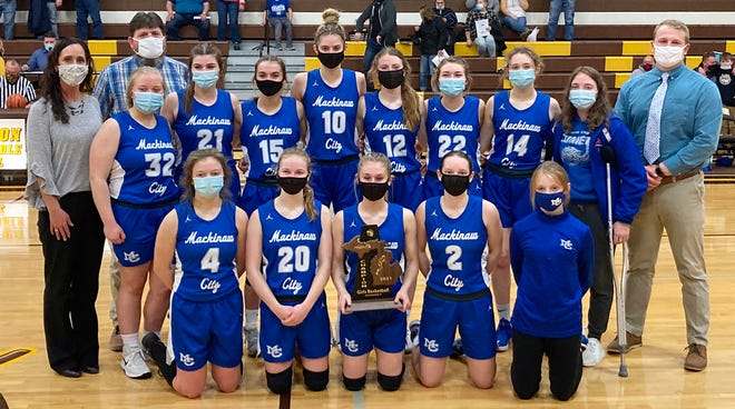 The Mackinaw City girls' basketball team picked up a third straight district championship Wednesday in Pellston. Team members include: Gabi Bell (2), Mia House (4), Madison Smith (10), Larissa Huffman (12), Caroline Somers (14), Marlie Postula (15), Gracie Beauchamp (20), Julia Sullivan (21), Carissa Sroka (22), Raeann Hingston (23), Jersey Beauchamp (Inj.) and Ella House (32). Coaches include: Jake Huffman (head), Natalie Postula and Elijah May.