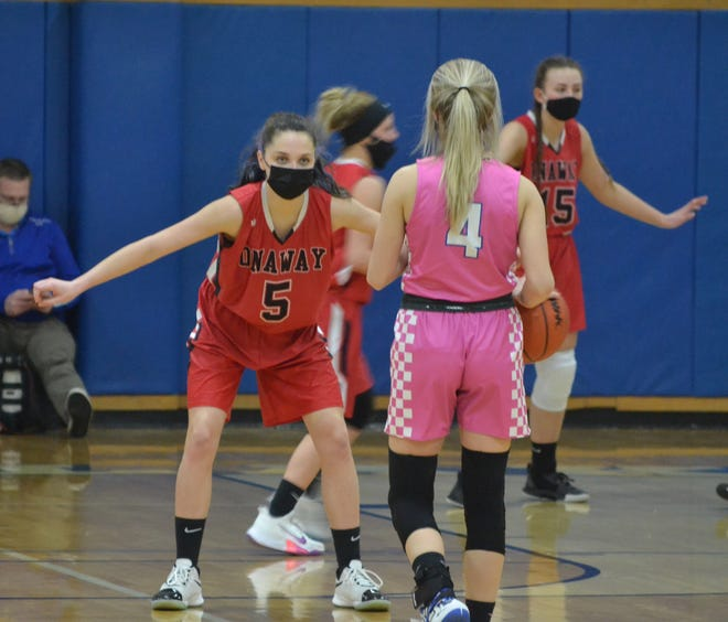 Onaway sophomore Madilyn Crull (left) defends Inland Lakes senior Christy Shank (4) during a girls basketball contest from earlier this season. Crull scored a career-high 13 points to help lift the Cardinals to a district semifinal win over the Bulldogs in Wolverine on Wednesday.