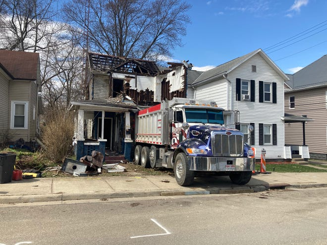 Crews from Lehotay Trucking and Excavating are razing an abandoned residence on North Eighth Street in Cambridge for the Guernsey County Land Bank. Workers were tearing down the structure by hand due to the close proximity of the neighboring homes.