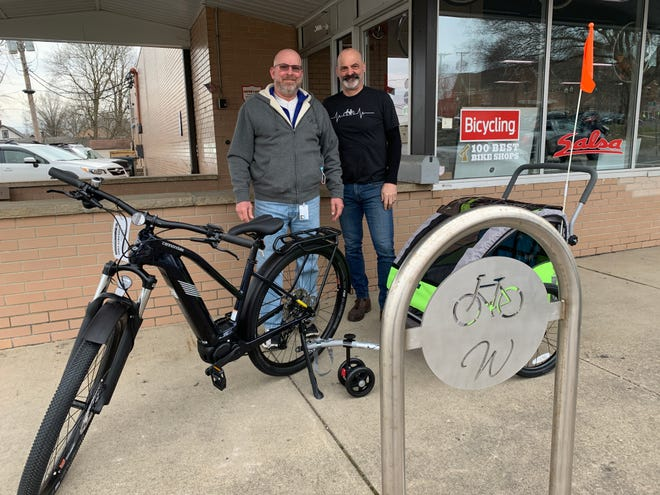 Wooster Recreation and Community Center manager Jeff Battig and Ride On owner Bill Buckwalter invite families to participate in the Wayne Trails' Run, Walk & Roll scavenger hunt on June 19.