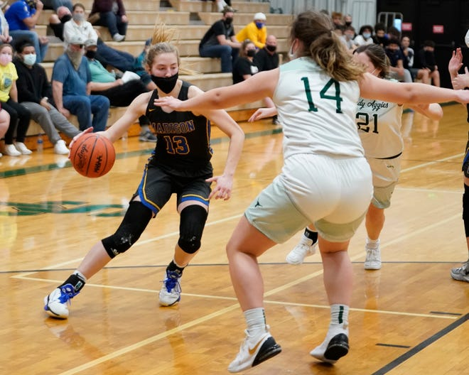 Madison's Carly Anschuetz drives the during Wednesday's Division 3 district semifinal at Sand Creek.