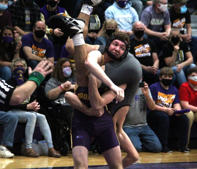 Bronson's Ben Thomas Grate find himself in an interesting situation during his match with Union City's Maddox Miller Wednesday night. Thomas Grate won via pin fall.