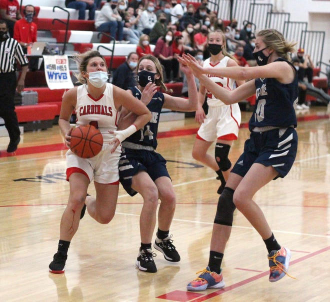 Coldwater's Mallory Wilber goes strong to the bucket in her first game back from injury since early in the season. Wilber led the Cardinals in scoring with nine points.