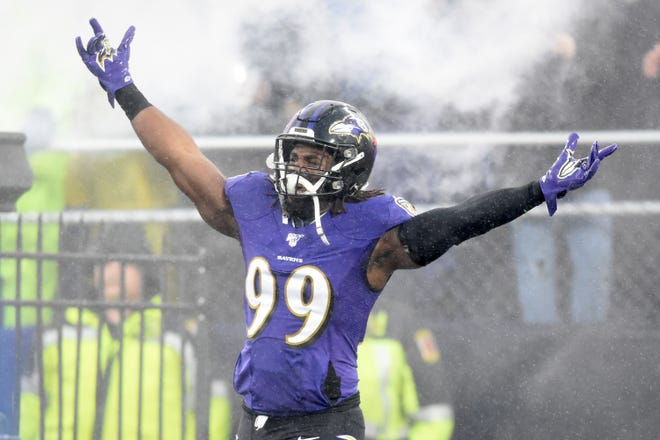 Matt Judon, shown in his Baltimore Ravens uniform in December 2019, says that he and his family celebrated his new contract with the Patriots at Disney World.