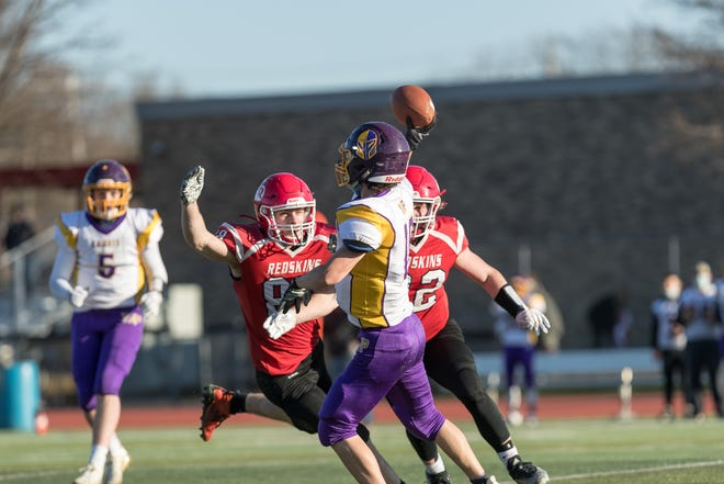 The Canisteo-Greenwood defense swarms the ball during Saturday's win over York/Pavilion.