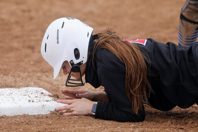 Southeastern Community College's Makayla Cam (2) beats the pick off attempt during the second game of a  double header against Kirkwood Community College Wednesday March 24, 2021 at SCC's Wagner Athletic Complex.
