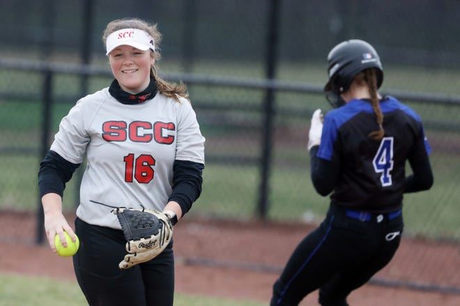 Southeastern Community College's Abigayle Miller (16) smiles after catching a pop fly for the out during the first game of a  double header against Kirkwood Community College Wednesday March 24, 2021 at SCC's Wagner Athletic Complex.