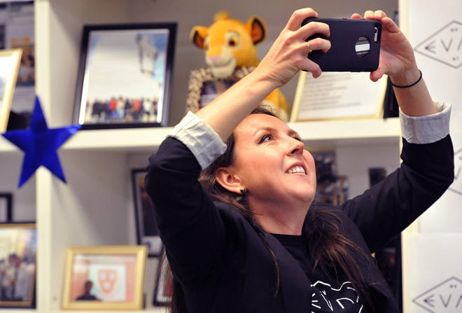 Amy Donofrio records her students as they find out their group, EVAC Movement, was named winner of a national kindness challenge in a file photo from 2017.