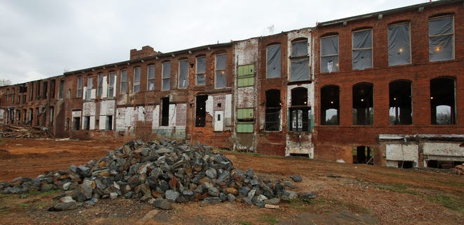 Work continues on the old Chronicle Mill on Catawba Street in Belmont Thursday morning, March 25, 2021.