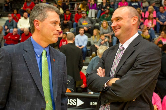 Rock Island High School boys basketball coach Thom Sigel, left, talks with Galesburg coach Ryan Hart prior to the Silver Streaks' home game with the Rocks on Jan. 20, 2020. A former Galesburg assistant, Sigel announced on social media Tuesday that he is retiring from coaching after 20 years at Rock Falls and Rock Island.