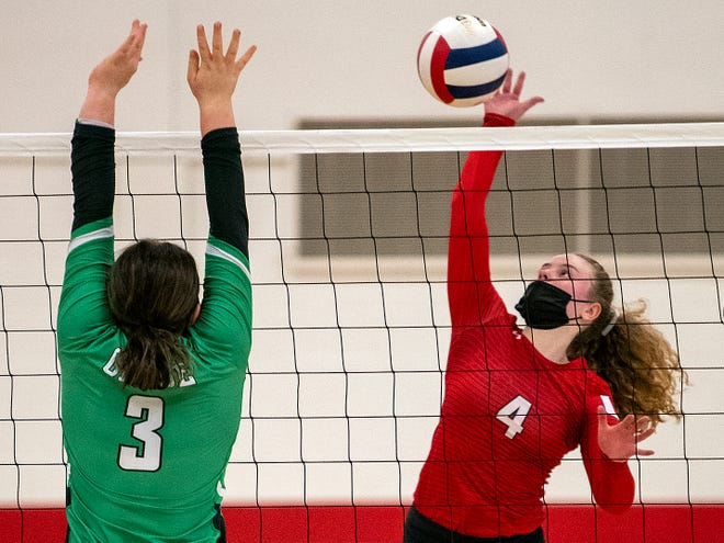 United High School junior Veronica Miller, right, prepares to spike the ball as Wethersfield's Emma Ellenberger defends during the Red Storm's 2-1 win over the Flying Geese on Wednesday, March 24, 2021 in Monmouth.