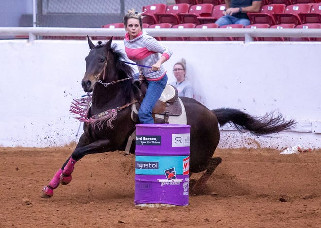 Jessica Huntington of Bluff Dale, Texas, and Sugar Bar Dash, finish their run in 16.636 on Wednesday night at the Jackpot at the Expo in Glen Rose.