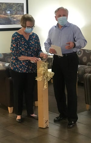 Ray Reynolds and his wife Debbie accept a gift at a recent retirement party thrown by the staff Glen Rose Medical Center.