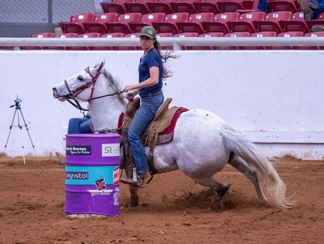 Dublin's Bille Ann Harmon and her horse Sugar complete a run in 15.994 on Wednesday night at the Jackpot at the Expo in Glen Rose.