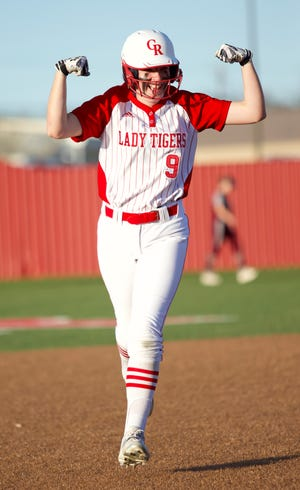 Glen Rose's Mallory Goff flexes her muscles after belting a solo homer in the first inning Tuesday night.