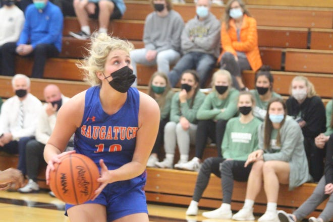 Saugatuck senior Zoe Myers goes up for a layup in the first half of their loss to North Muskegon on Wednesday, March 24, 2021