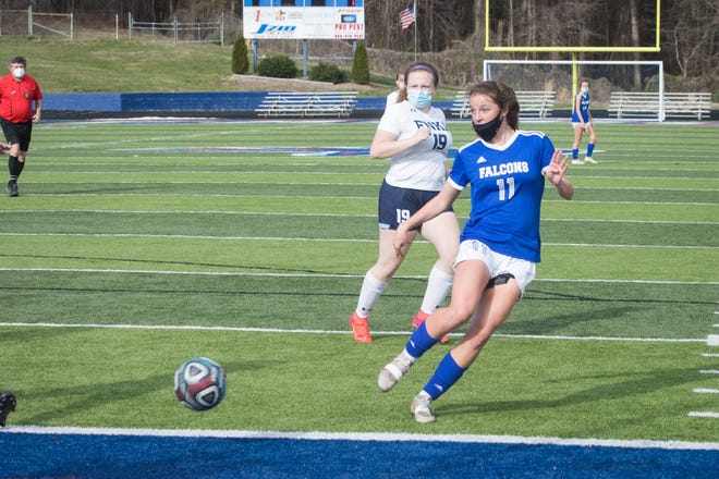 West Henderson freshman Marianne Maxon scores a goal for the Falcons Wednesday night at home against Enka.