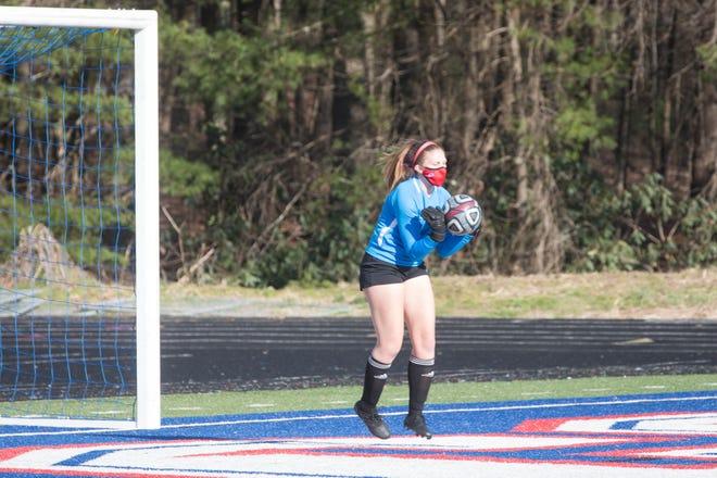 West Henderson senior goalkeeper Margaret-Ann Littauer gets a save Wednesday against Enka at Johnson Field.
