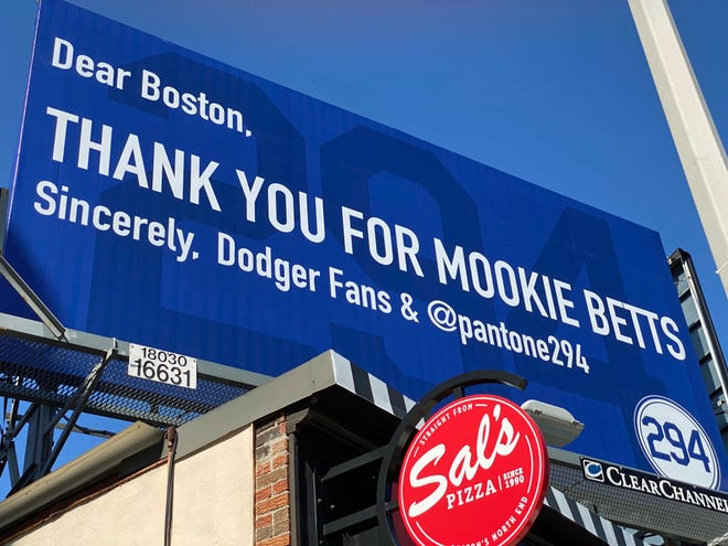 Hanging on a billboard outside of Fenway Park is a sign thanking Boston for trading Mookie Betts to the Los Angeles Dodgers last year. The sign was paid for by Alexander Soto, who is the chief executive officer of Pantone 294 – a Dodgers' fan group. Betts is one of the best players to ever play for the Sox. He was traded to the Dodgers in the winter of 2020 and went on to help lead LA to its first World Series championship since 1988 while the Sox had one of their worst seasons in many years. The billboard is on Brookline Avenue near the Green Monster.