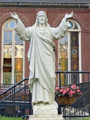 This is the statue of Jesus in the Peace Garden at the St. Leonard of Port Maurice Roman Catholic Church on the corner of Hanover Street and Prince Street in the North End.
