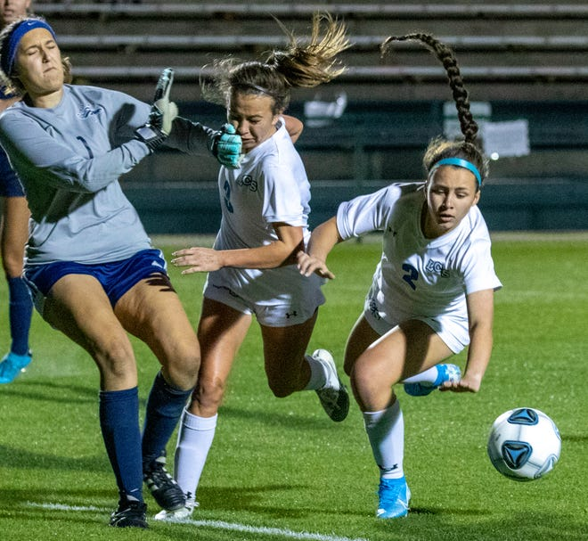 Lakeland Christian's Kate Carnes collides with American Heritage's goalkeeper as Lily Harrington goes after the ball during the first half of the Class 3A state championship game.