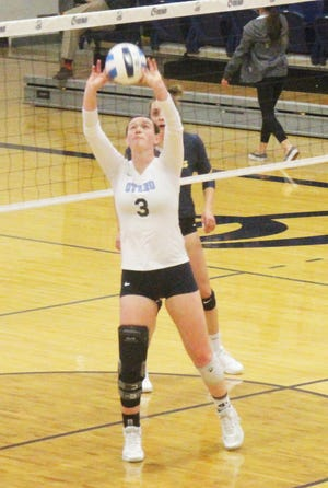 Otero Junior College's Reyna Isenbart sets up a kill attempt in Wednesday's match at the McDivitt Center. Isenbart had 28 assists as the Rattlers defeated the Trojans in four sets.