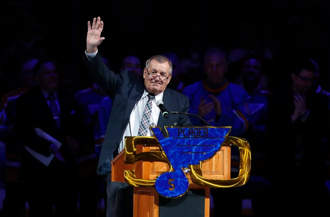FILE - In this Thursday, Feb 2, 2017 file photo, Former St. Louis Blues player Bob Plager waves to fans while speaking during a ceremony to retire his number before an NHL hockey game between the Blues and the Toronto Maple Leafs in St. Louis.